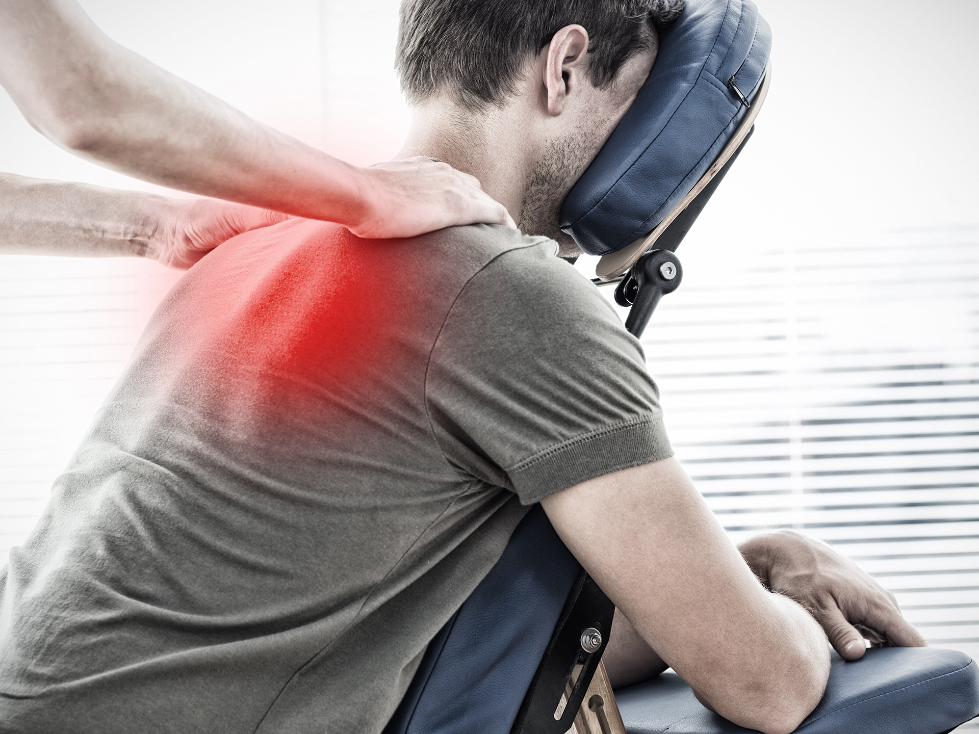 Composite image of physiotherapist giving shoulder massage to